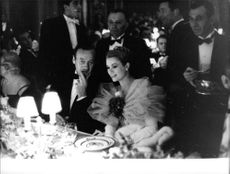 Prince Paul of Yugoslavia talking to his guests in a Party.