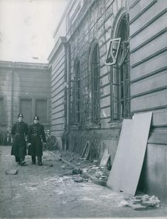 Two military officers checking the explosion in a building in Stockholm. 1946.