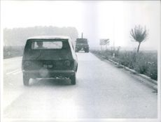 The new Italian car Fiat 128 moving ahead on the road.