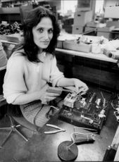 A woman assembles small-scale projectors at the small company ED Liesegang, which manufactures optics