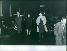 Jacues Massu is walking with colleagues. 1965