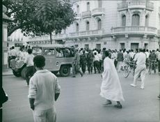 Vintage photo of Tunisian people and soldiers gathered on the street. Photo taken on July 31, 1961.