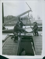 A nun under the boat in France, 1914.
