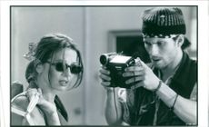 Victoria Abril as Lorraine de la Pena and Christian Slater as William in the film Jimmy Hollywood, 1994.