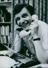 Jiri Suchy talking on the telephone.
