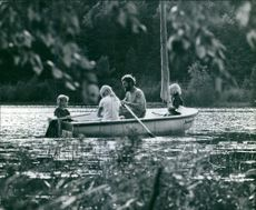 A family floatin on a rowboat.