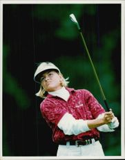 Action image of golf player Lotta Neuman taken in an unknown competition context.