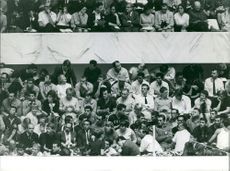 People sitting in the stadium, with some prominent persons, coaches and athletes.