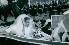 Queen Sonja of Norway with her husband Harald V of Norway sitting in car after their wedding