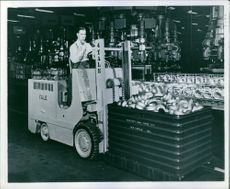 A photo of a man working in the factory of Chrysler Company.