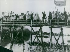 People crossing the bridge, rallying, in Vietnam, January 29, 1964.