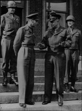 English King George VI in conversation with General Eisenhower flanked by General Bradley and General Hodges