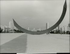 The Olympic arc with the Olympic village in the background