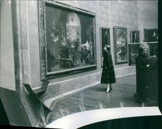 Betsy Blair looking at the painting in the museum.