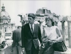 Prince Xavier of Bourbon-Parma visiting historical site with woman.