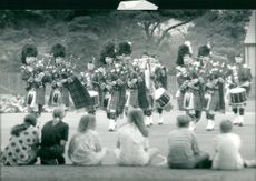Bagpipe players in full uniform.