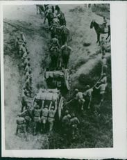 Sino-Japanese War 1939 Japanese military men were climbing up the high mountain with combat supplies and trucks loaded with military supplies