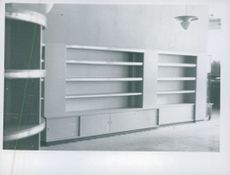 Empty shelves in shop Christiania Glasin Olso, Norway 1943.