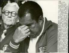 Clifford Buck and American Wright Trainer Stan Wright at a press conference during the 1972 Olympic Games