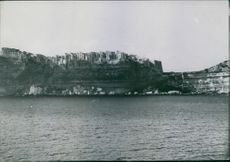 View of houses on the top of cliff in Bonifacio, Corsica. Photo taken in August 1935.