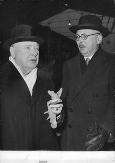 Winston Churchill standing with Rene Pleven.
