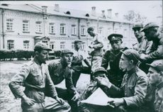 "A group of soldiers of the Lithuanian People's Army discuss articles which they read in the newspaper ""Soldatskaya Pravda."" 1940."