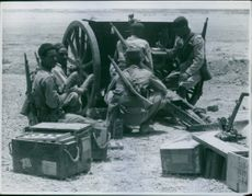 The Royal Corps of Colonial Troops fixing the cannon during the war, 1940.
