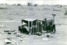 Vietnamese locals collecting empty cannon shells.