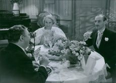 "Anne-Marie Brunius, Ragnar Arvedson, and Erik Berglund in a scene from the 1936 Swedish drama film, ""Honeymoon"""