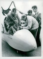 Prince Philip with Derek Piggett from Surrey Gliding Club in a glider after a test trip during the National Gliding Championships in 1957