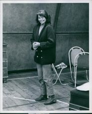"""Eva Bartok, rehearsing her part in """"The Lacropulos Secret"""" at the Brunswick Boy's Club while she's wearing a coat in a cold year in London."""