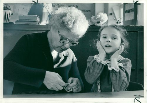 Schools 1980-1987:Beatrice Stewart helping children.