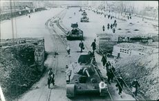 Soldiers moving with their tank on the railway tracks during the Russian civil war.