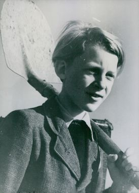 A photo of a young boy holding a shovel.