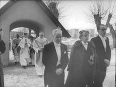 Adolf Sweden, May Starck and Sven Persson leads the procession for the new vicar Brother Axel Lindörn.