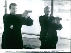 Steven Seagal and Keenan Ivory star in Warner Bros. action-thriller, The Glimmer Man.
