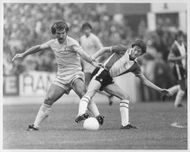 Graeme Souness and Steve Williams are fighting for the ball