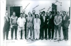 A group of men in suit.