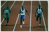 Linford Christie versus two other men.