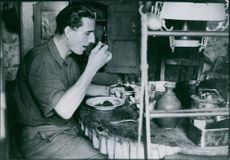 Mouvault, the assassin, now keeper of the lighthouse on the Ile de Salut, enjoying his lunch. 1939