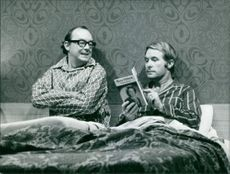 Eric Morecambe and  Ernie Wise in a film scene.