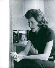 Eunice Mary Kennedy Shriver sitting and looking away.