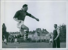 Football Player jumping over the rope, during the training.