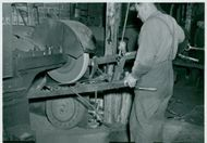 John. Grinding a plow body into the cradle