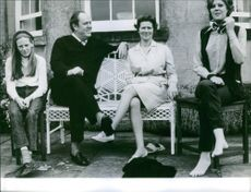 Christopher Soames with wife, Mary Soames with 2 women sitting.
