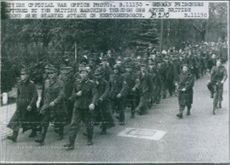 German prisoners marching with British troop.