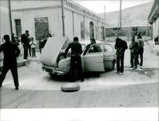 Men working on car.