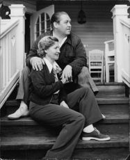 "Johan Jonatan ""Jussi"" Björling sitting with a woman on stairs."