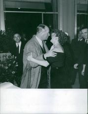 Maurice Chevalier with woman