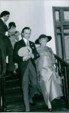 1st Earl Alexander of Tunis climbing down the stairs with Margaret Alexander. 1970.